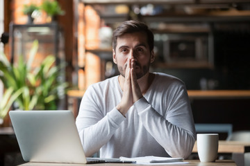 Thoughtful doubtful businessman in tension thinking make difficult decision