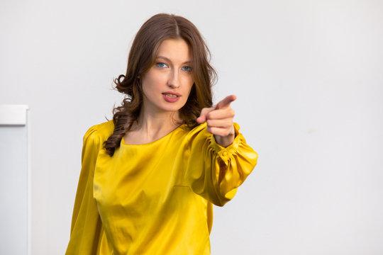 the female teacher points her finger towards the classroom