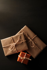 Kraft paper gift packages with black background