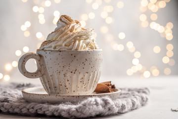 Poster Chocolate Hot chocolate with cream and cinnamon stick in a ceramic cup. The concept of winter time.