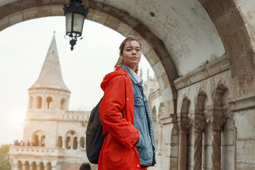 Young woman with blonde hair in the Fisherman's Bastion in the Castle district of Budapest