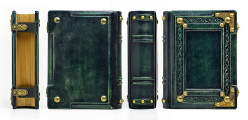 Green leather book with the embossed frame, recessed blank central part and the brass corners.
