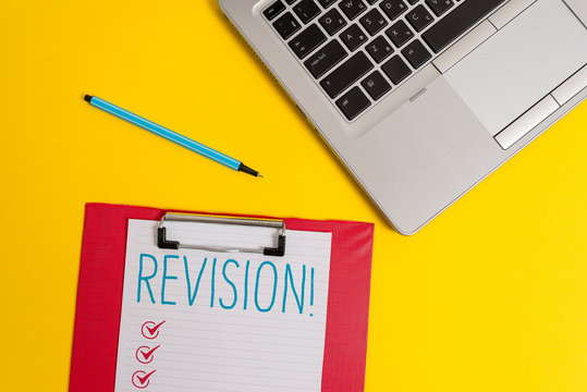 Writing note showing Revision. Business concept for action of revising over someone like auditing or accounting Trendy metallic laptop clipboard paper sheet marker colored background