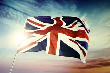 United Kingdom flag with sunrise background