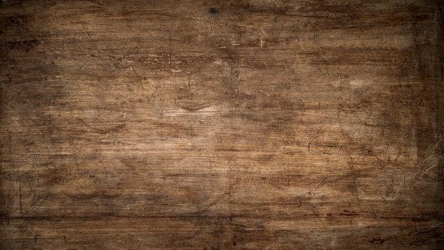 Textur einer alten, zerkratzten Platte aus Holz als Hintergrund