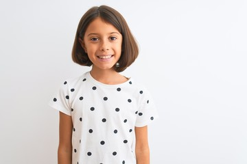 Young beautiful child girl wearing casual t-shirt standing over isolated white background with a happy and cool smile on face. Lucky person.