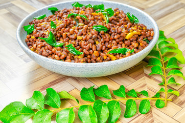 Close up of Red Cow Peas Curry and fresh surrounded curry leaves with water drops