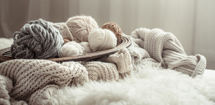 Still life with a cozy variety of yarn for knitting.