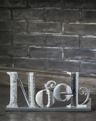 isolated holiday noel with brick wall