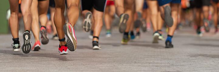 Marathon running race, people feet on city road Fotomurales