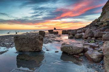 Wall Mural - Stunning sunrise over Saltwick Bay near Whitby