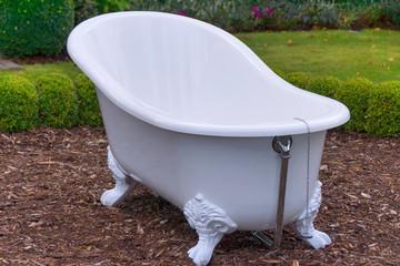 White vintage style bathtub in a garden