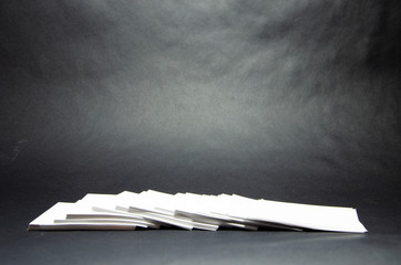 stack of white paper small squares stickers on black background