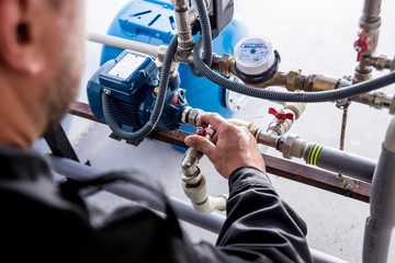 Technician checking water system nodes.