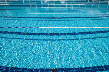 Wall Mural - Olympic Swimming pool background on a bright Sunny day