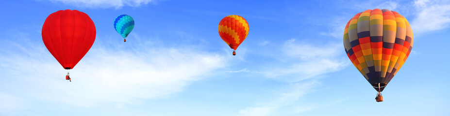 Fotobehang Ballon Colorful hot air balloons flying in the bright blue sky. Panorama