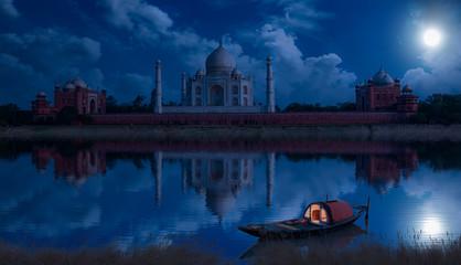 Fototapete - Taj Mahal Agra on a full moon night as seen from Mehtab Bagh on the banks of river Yamuna. Taj Mahal is a UNESCO World Heritage site and a Mughal architecture masterpiece