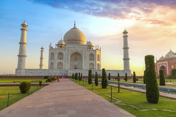 Wall Mural - Taj Mahal Agra with moody sunrise sky. A UNESCO World Heritage site at Agra India