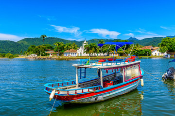 Wall Mural - Historical center of Paraty with boat, Rio de Janeiro, Brazil. Paraty is a preserved Portuguese colonial and Brazilian Imperial municipality