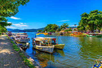 Wall Mural - Embankment of historical center with boats in Paraty, Rio de Janeiro, Brazil. Paraty is a preserved Portuguese colonial and Brazilian Imperial municipality