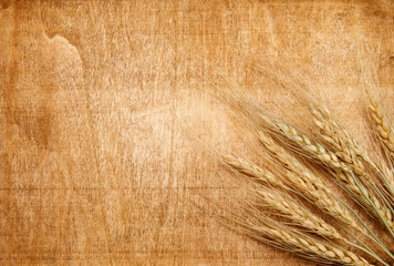 Wall Mural - wheat on the wood background