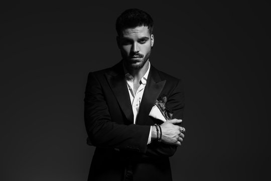 black and white portrait of a sexy  man in tuxedo