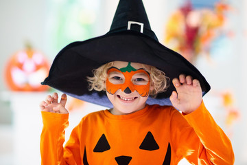 Child in Halloween costume. Kids trick or treat. Wall mural