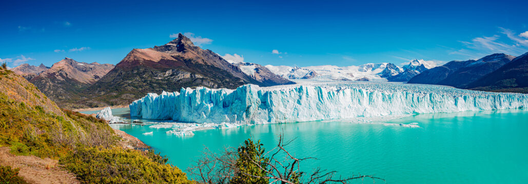 Panoramic view of the gigantic Perito Moreno glacier, its tongue and lagoon in Patagonia in golden Autumn, Argentina