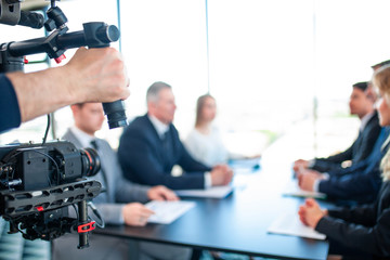 Videographer filming business meeting