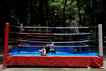 Children play on a boxing ring in Caracas