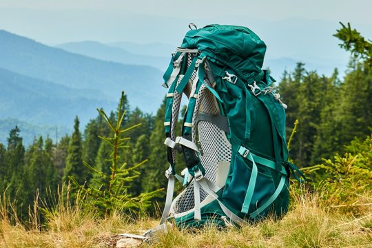 Tourist backpack close-up in nature. Hiking theme, the theme of rest