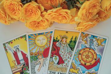 Miami, Florida. August 24, 2019. Tarot cards, illustrative editorial Rider Waite tarot cards. Yellow roses background.