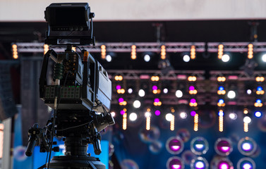 Professional video camera is ready to shoot the concert.