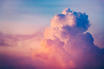 Close-up colorful clouds on sunset sky. Breathtaking scenery the splash of violet, purple, blue and scarlet tints. Ideal background for creating of collages and illustrations.