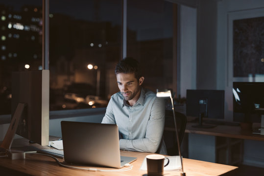 Young businessman working late at night in an office