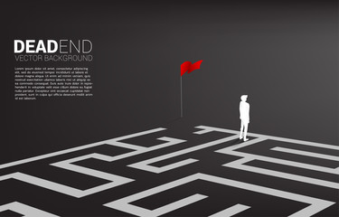 Silhouette of businessman at dead end of maze. Business concept for problem and wrong decision. Wall mural