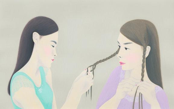 Two women braiding hair