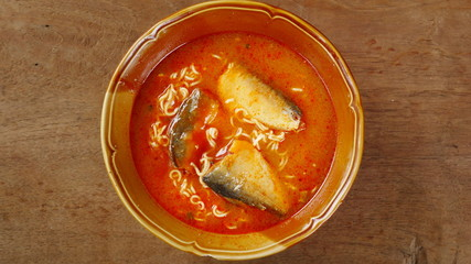 red chili noodle soup, Japanese Ramen and fish, tomato sauce in a bowl
