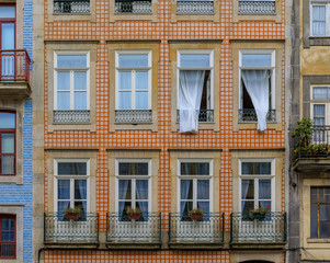 Facades of traditional houses decorated with ornate Portuguese azulejo tiles in Porto, Portugal