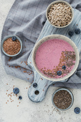 Ingredients for making pink yogurt smoothie bowl with blueberry and seeds
