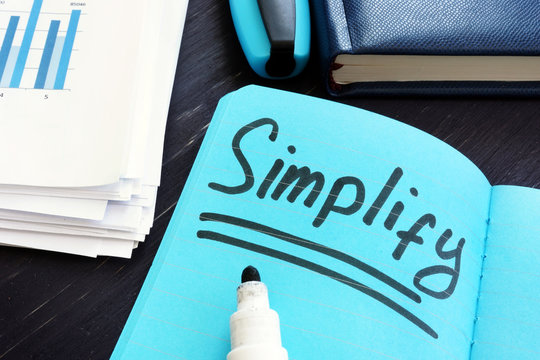 Simplify written on a page. Simplicity concept.