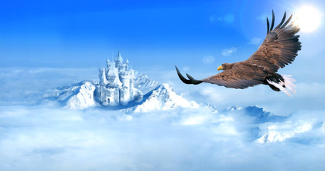 Eagle flying towards ice castle in snow mountains aerial view