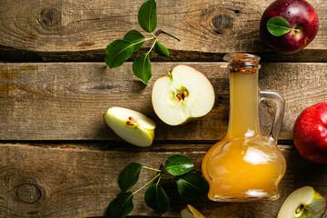 Apple cider in glass jar, wood background