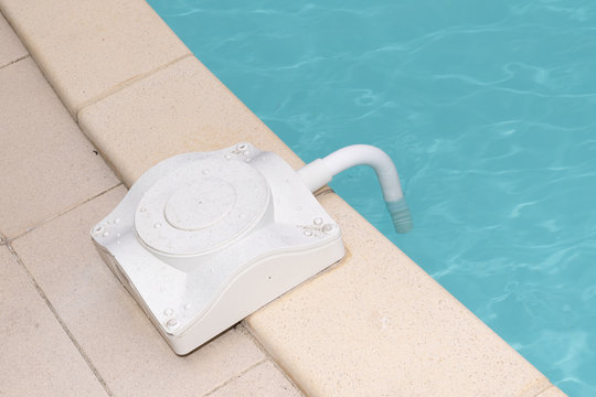 Swimming pool alarm on side of a home private family pool