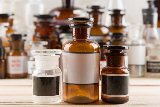 Retro pharmacy - vintage pharmacy bottles on wooden board