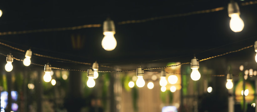 outdoor party string lights glowing at night
