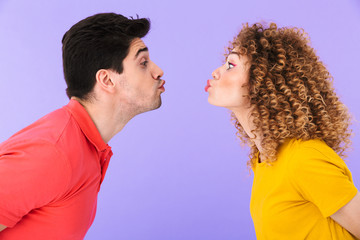 Portrait of caucasian couple man and woman kissing each other with eyes closed while standing face to face
