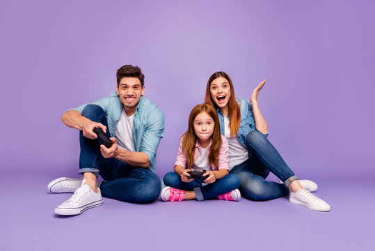 Photo of three family members sitting floor trying hard to win team game wear casual clothes isolated purple background