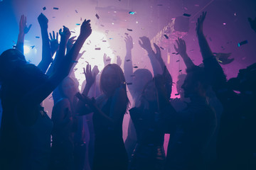 Wall Murals Dance School Close up photo of many party people dancing purple lights confetti flying everywhere nightclub event hands raised up wear shiny clothes
