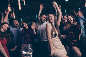 Nice-looking attractive lovely glamorous shine cheerful cheery glad positive elegant stylish diverse ladies and gentlemen having fun festal occasion in modern fashionable luxury place indoors